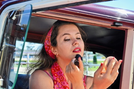 Young woman at vintage car and fashion show in Auckland, New Zealand