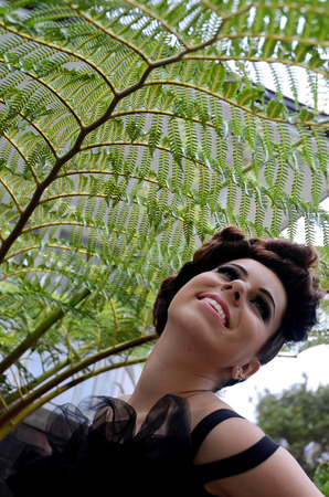 silver fern: Smiling New Zealand girl in the shade of the SILVER FERN - the national symbol of New Zealand