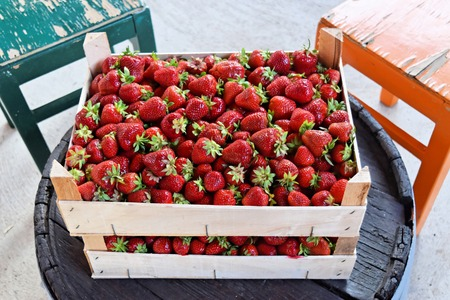 Fresh strawberries in wooden boxes