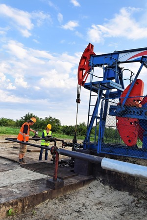 Two petroleum engineers  at work on an European oil well