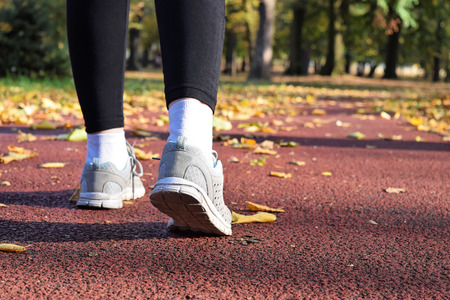 Jogging in the park during fall season