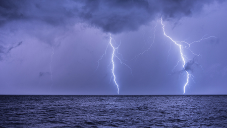 A lightning strike in the middle of the Adriatic Sea in Croatia Stock Photo
