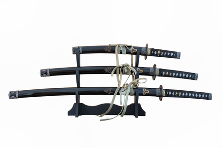 Three isolated katana's on a stand with white background Stock Photo - 82928601