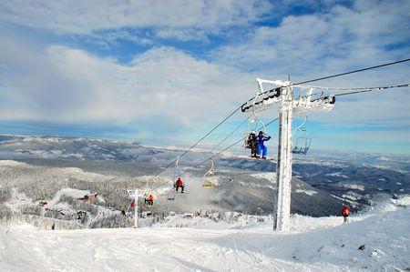 icily: Skiers on a ski lift