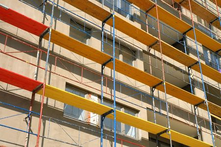 condos: Scaffold of various colors on construction site  Stock Photo