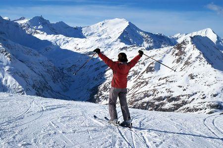 Female skier expressing joy photo