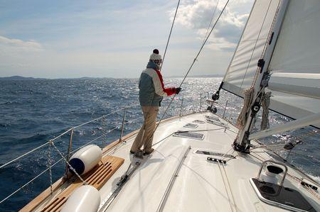 navigational light: Sailing toward sun on a late winter day Stock Photo