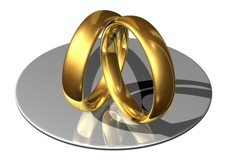 Golden wedding rings leaning against each other photo