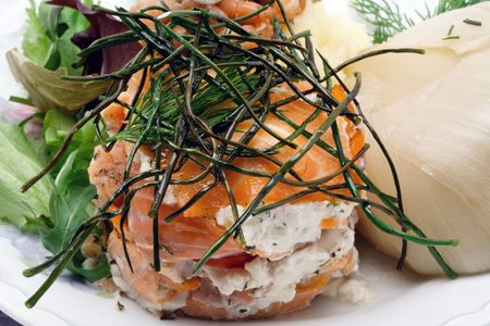 encapsulated: Smoked salmon with creamy cheese decorated with chive close-up