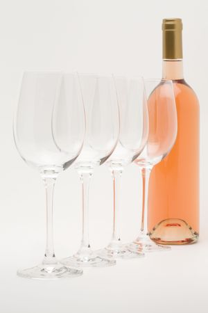 rose wine bottle with wineglasses lined up Stock Photo - 3070246