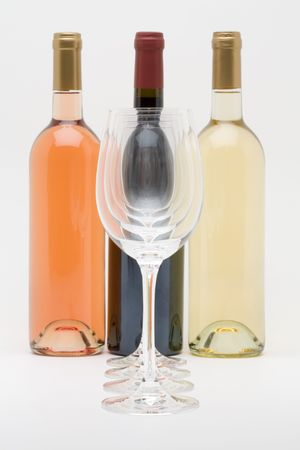 red white and rose wine bottles with glasses in front Stock Photo - 3070571