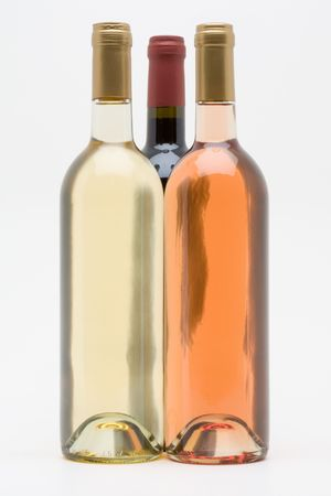 red white and rose wine bottles photo