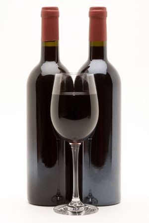 red wine bottles with filled wineglass Stock Photo - 3070572