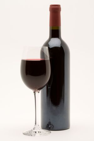 red wine bottle with filled wineglass in front Stock Photo - 3070238