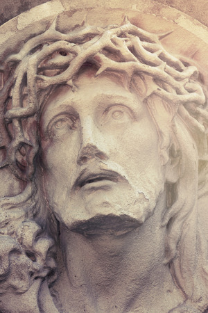 crucified: Close up dramatic statue of crucified Jesus Christ  (details)