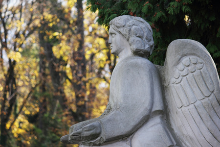 Figure of a praying angel in the cemetery