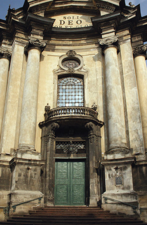Facade of the Dominican church in the old part of Lviv. Under the dome of the church is a quotation in Latin from the first letter to Timothy