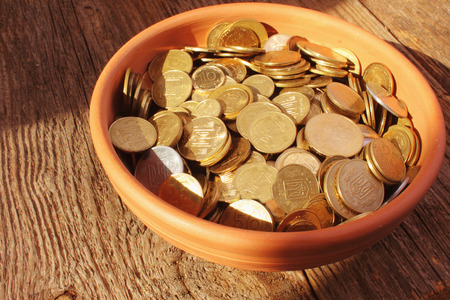baclground: coins on brown baclground of wooden