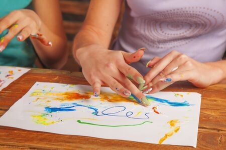 Art and creativity concept. Young beautiful women painting with fingers.  Archivio Fotografico
