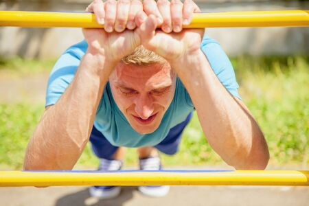 Sport, health and lifestyle concept. Young man sportler is training on the street.