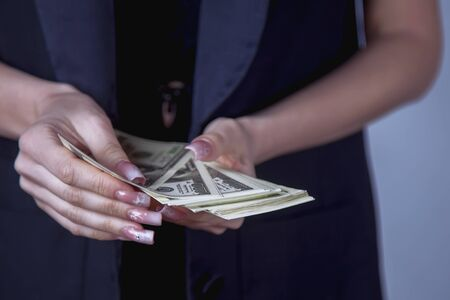 Business woman holding US Dollar banknotes. Money, wealth, work, salary concept Archivio Fotografico