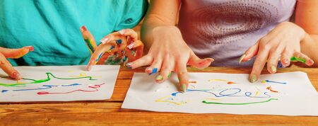 Art therapie and creativity concept. Close up young women painting with finger.