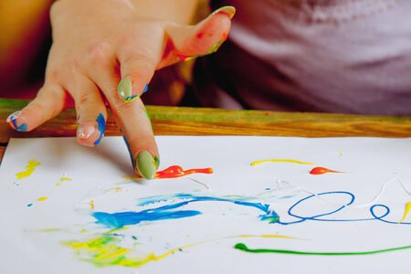 Art therapie and creativity concept. Close up beautiful young woman painting with finger Archivio Fotografico