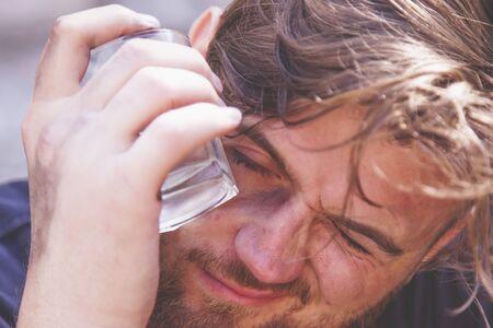 Close up drunk man with glass of vodka. Alcohol addiction concept. Archivio Fotografico
