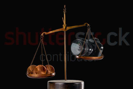Editorial conceptual image: A few cents per photographer's work on the background of Shutterstock contributor inscription as symbol of depreciation of the work of photographers. Editoriali
