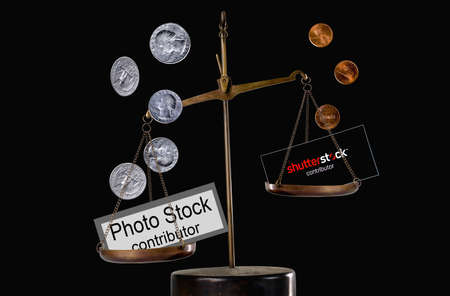 Editorial conceptual image: A few cents per photo with the Shutterstock contributor inscription as symbol of depreciation of the work of photographers.