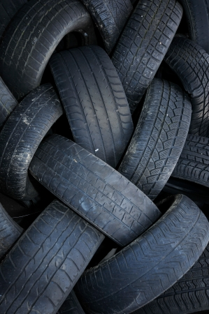a pile of used car tires photo