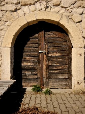 closed wooden door of a wine cellar