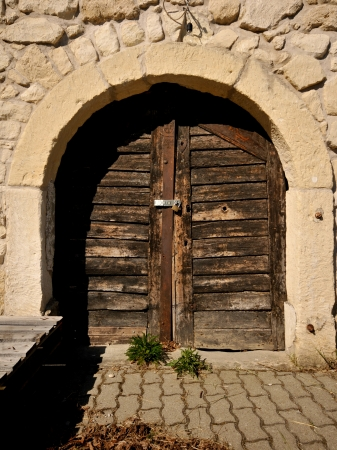 closed wooden door of a wine cellar