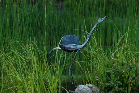metal figure at the swimming pond photo