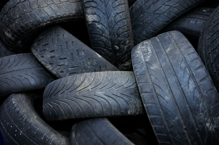 a pile of used car tires