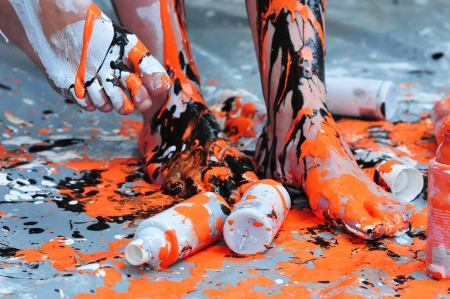 bodypainting: legs painted with black and orange color Stock Photo