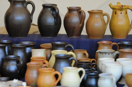a jar stand: many pots positioned on a table for sale