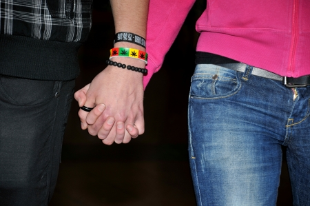 young coupe holding hands