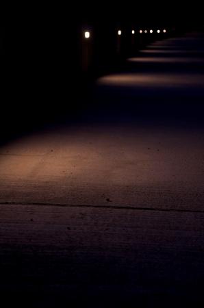 row of spotlights at night