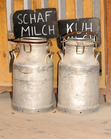 antique milk cans Stock Photo