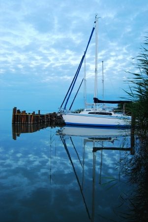 sailboat at sunrise photo