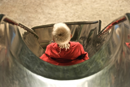 occiput: boy slipping down a slide