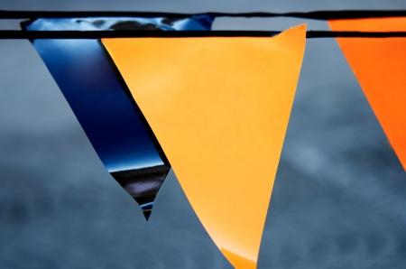 three cornered: orange and blue triangular pennants Stock Photo