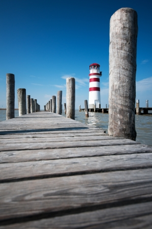 wooden bridge and lighthouse against the deep blue sky in Burgenland Neusiedlersee photo