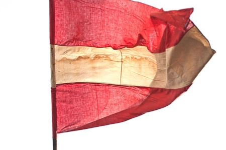 austrian flag in the wind isolated on white photo
