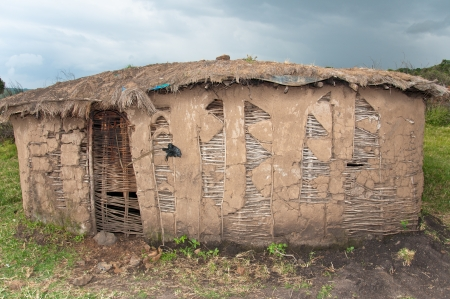 hut in the masai village in kenya photo