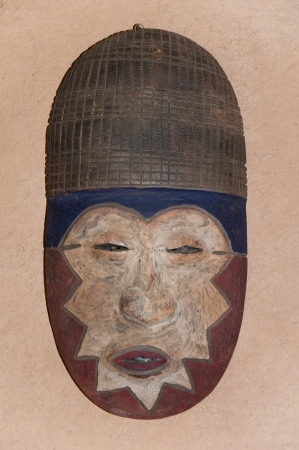 african traditional mask on the wall photo