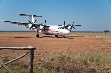parked airplane in the national park masai mara in kenya