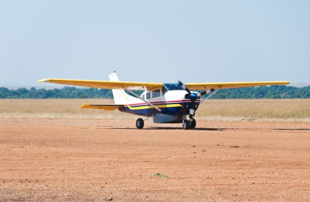 parked aeroplane on the airport in the national park masai mara in kenya