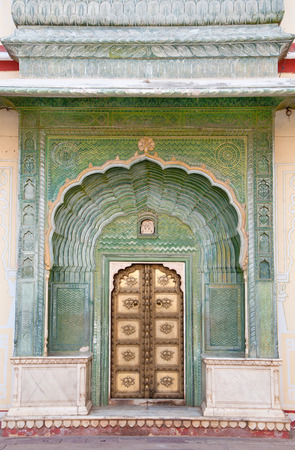 ancient india: green door of the city palace chandra mahal in india